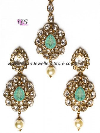 American diamond Indian earrings & tikka in mint green IAGA11114